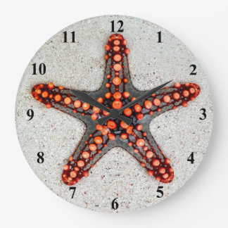 Bright Orange Red Starfish on White Sand Wallclock