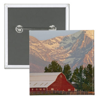 Bright red barn against Mission Mountains in 15 Cm Square Badge