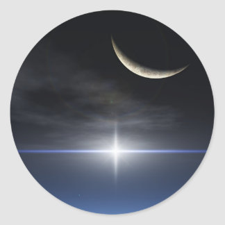 Bright star over a reflective snow covered cloud classic round sticker
