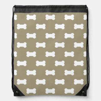 Bright White Dog Bones On khaki Beige Background Drawstring Backpacks