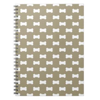 Bright White Dog Bones On khaki Beige Background Notebooks