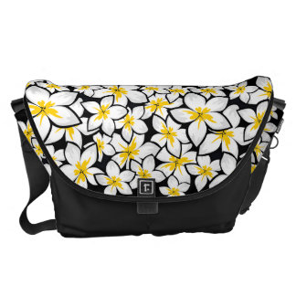 Bright yellow and white frangipani art on black courier bags