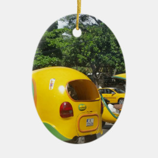 Bright yellow fun coco taxis from Cuba Ceramic Oval Decoration