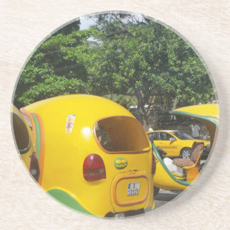 Bright yellow fun coco taxis from Cuba Coaster
