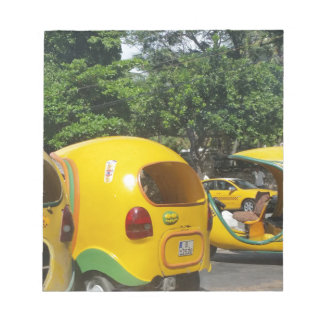 Bright yellow fun coco taxis from Cuba Notepad
