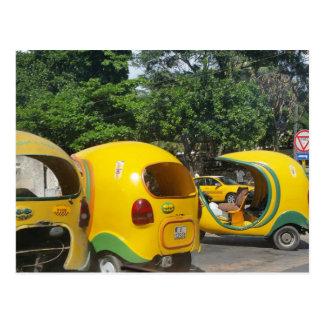 Bright yellow fun coco taxis from Cuba Postcard