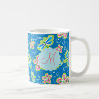 Brillant flowers, dragonflies and swirls on blue coffee mug