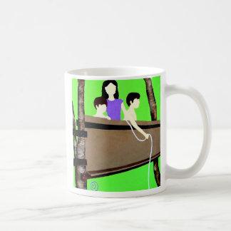 bringing up the cat. coffee mug
