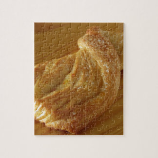 Brioche on a wooden table jigsaw puzzle