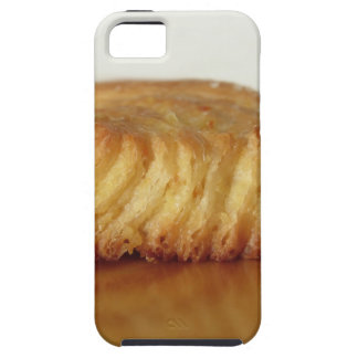 Brioche on a wooden table with granulated sugar case for the iPhone 5