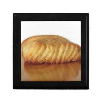 Brioche on a wooden table with granulated sugar gift box
