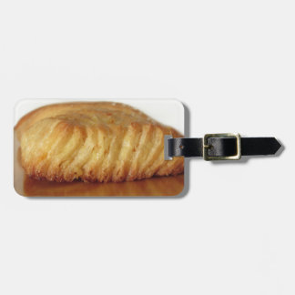 Brioche on a wooden table with granulated sugar luggage tag