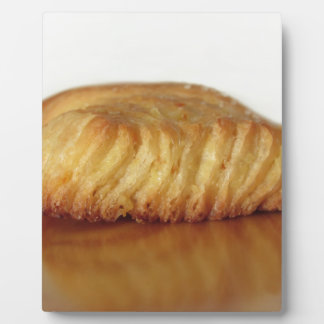 Brioche on a wooden table with granulated sugar plaque