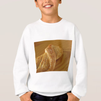 Brioche on a wooden table with granulated sugar sweatshirt