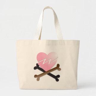 broken heart on crossbones bag