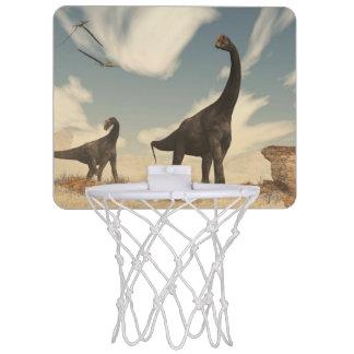 Brontomerus dinosaurs in the desert - 3D render Mini Basketball Hoop