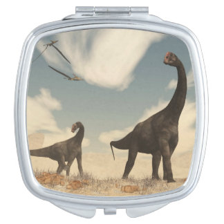Brontomerus dinosaurs in the desert - 3D render Travel Mirrors