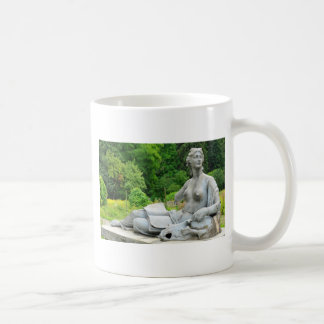 Bronze statue depicting woman coffee mug