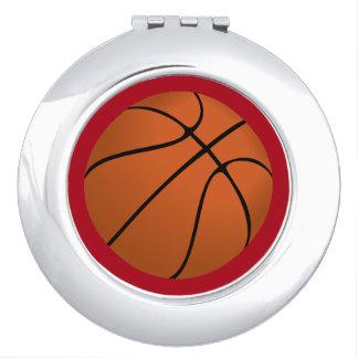 Brown Basketball Ball on Dark Red Travel Mirror
