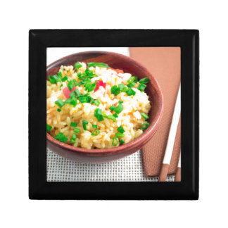 Brown bowl with a portion of cooked rice gift box