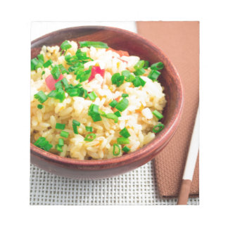 Brown bowl with a portion of cooked rice notepad