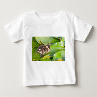 Brown duckling walking on water lily leaves baby T-Shirt