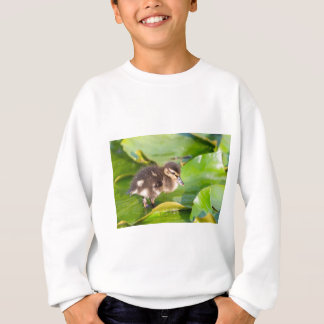 Brown duckling walking on water lily leaves sweatshirt