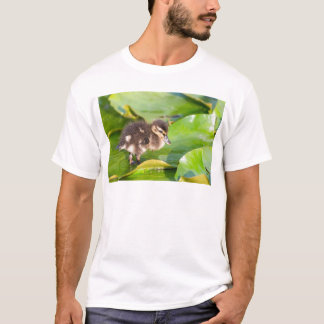 Brown duckling walking on water lily leaves T-Shirt