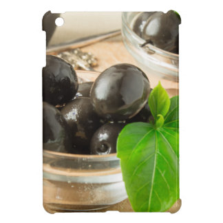Brown pickled olives on the old wooden background cover for the iPad mini