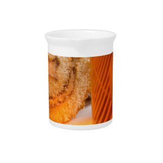 Brown sponge cake and cup of hot tea beverage pitchers