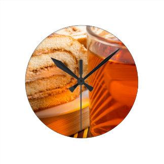 Brown sponge cake and cup of hot tea clocks
