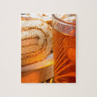 Brown sponge cake and cup of hot tea jigsaw puzzle
