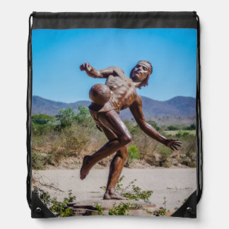 Brown Statue of Man kicking Futbol in Mexico Drawstring Bag