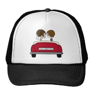 Brunette Bride and Groom in a Red Wedding Car Mesh Hats