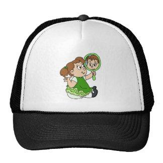 Brunette girl green dress cap