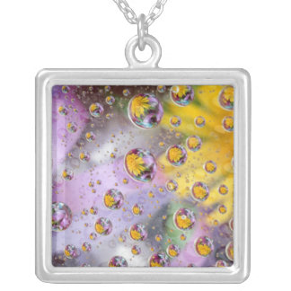 Bubbles abstract with flowers. Credit as: Nancy Square Pendant Necklace