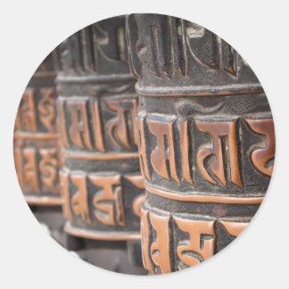 Buddhist prayer wheels round sticker