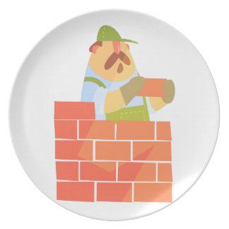 Builder Laying A Brick Wall On Construction Site Plate