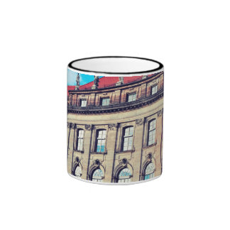 Building with statues coffee mugs