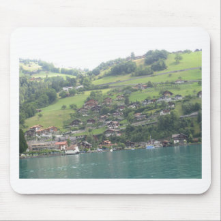 Buildings and greenery on shore of Lake Thun Mousepads