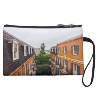 Buildings and Palm Trees in New Orleans Suede Wristlet