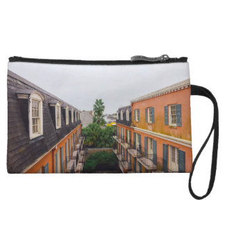 Buildings and Palm Trees in New Orleans Wristlet Purses