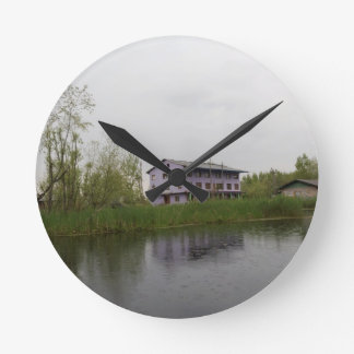 Buildings and shacks on patches of land round wallclocks