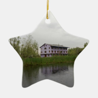 Buildings and shacks on patches of land christmas ornaments