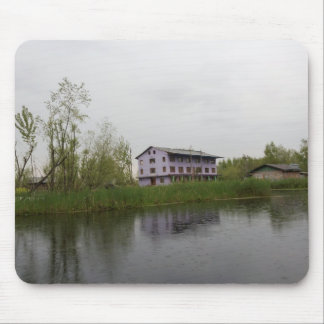 Buildings and shacks on patches of land mousepads