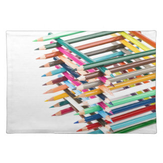 Built square construction of colored crayons place mats