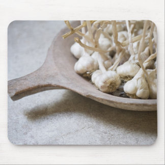 Bulbs of garlic in an earthenware bowl mouse pad