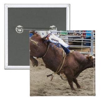 Bull rider at rodeo 15 cm square badge