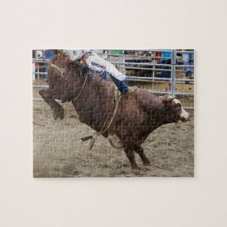Bull rider at rodeo jigsaw puzzle