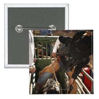 Bull rider tying rope on bull in the chute 15 cm square badge
